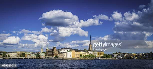 Stockholm spires blue summer skies over waterfront harbour panorama Sweden