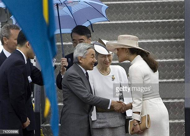 Japanese Emperor Akihito accompanied by Empress Michiko shakes hands with Swedish Crown Princess Victoria upon his arrival at Arlanda Airport in...