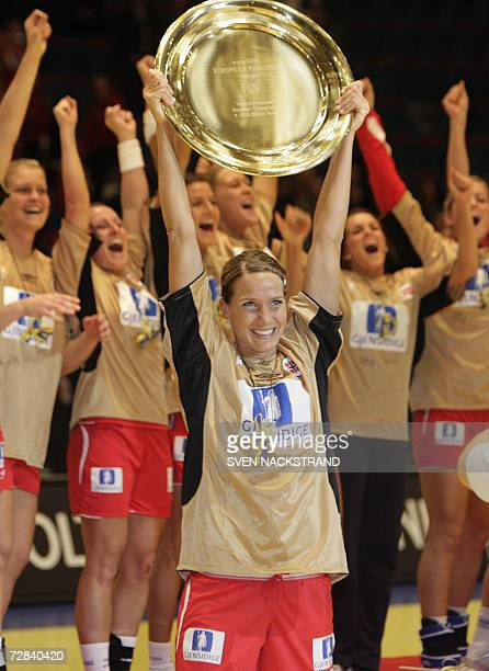 Norwegian captain Gro Hammerseng lifts the European Championships trophy after their victory against Russia in the final of the women's European...