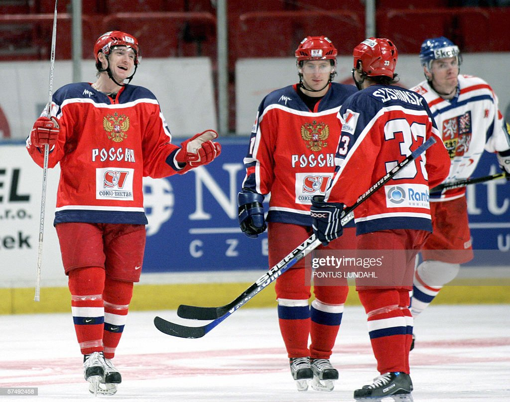 Russia's Ilya Nikulin celebrates with his teammates Maxim Sushinin and Alexander Kharitonov after scoring 74 to Russia against Czech Republuc during...