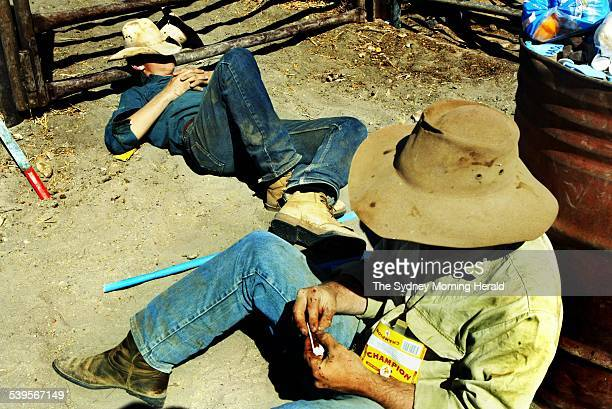 Stockmen relaxing Brunette Downs 17 august 2004 SMH Picture by BRENDAN ESPOSITO