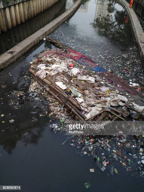 Stockpiles of garbe stuck at Ciliwung River Tanah Abang AreaCentral Jakarta Indonesia on 9 August 2017 Although there has been a lot of campaign in...