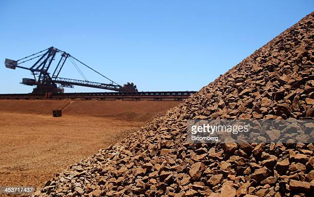 Stockpiles of iron ore sit at the ship loading facility at Fortescue Metals Group Ltd's Herb Elliott Port in Port Hedland in the Pilbara region...