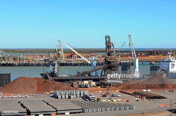 Stockpiles of iron ore sit on the docks waiting for shipment in Port Hedland Western Australia on Wednesday June 23 2010 Australia's Port Hedland is...