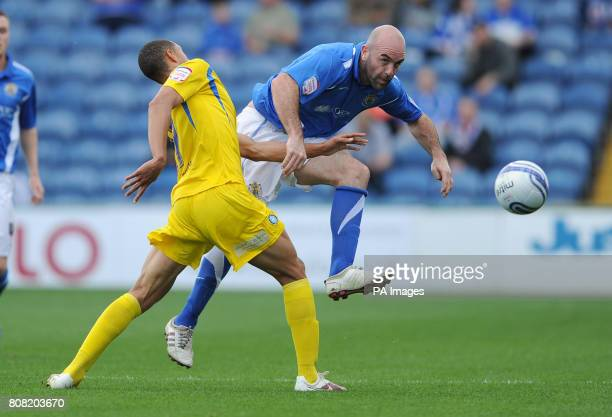 Stockport County's Barry Conlon and Wycombe Wanderers' Lewis Montrose battle for the ball during the npower League Two match at Edgeley Park Stockport