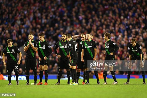 Stoek City players react during the penalty shoot out during the Capital One Cup semi final second leg match between Liverpool and Stoke City at...