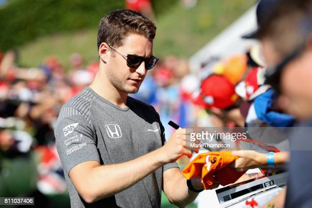 Stoffel Vandoorne of Belgium and McLaren Honda arrives at the circuit and signs autographs for fans before the Formula One Grand Prix of Austria at...