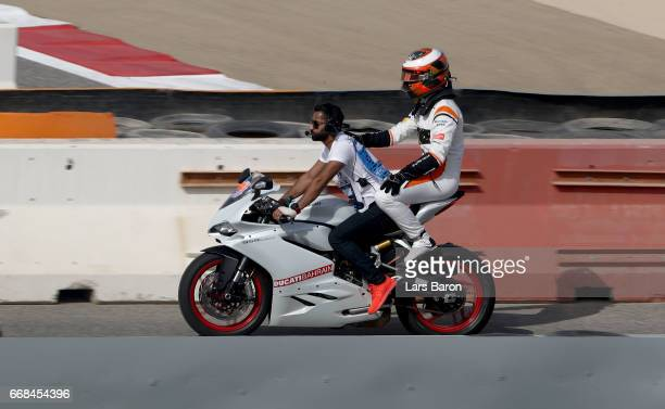 Stoffel Vandoorne of Belgium and McLaren Honda is given a lift back to the paddock after breaking down on track during practice for the Bahrain...