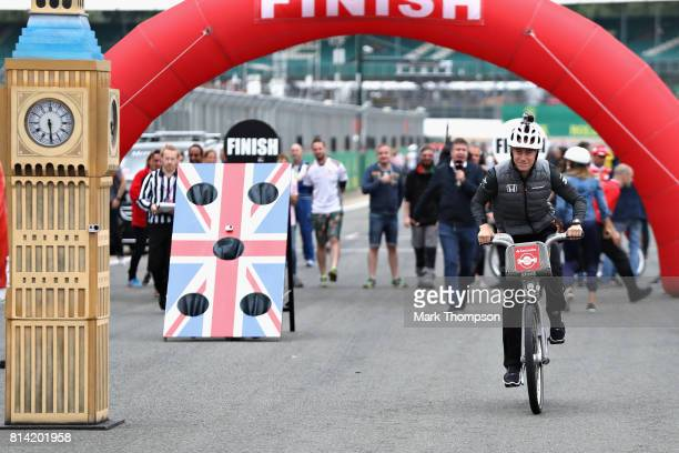 Stoffel Vandoorne of Belgium and McLaren Honda rides during the Santander Cycle Challenge at the 2017 British Grand Prix at Silverstone Circuit on...