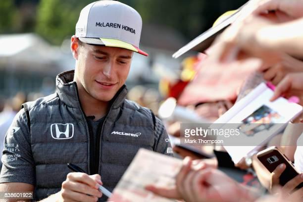 Stoffel Vandoorne of Belgium and McLaren Honda signs autographs for fans during previews ahead of the Formula One Grand Prix of Belgium at Circuit de...