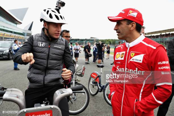 Stoffel Vandoorne of Belgium and McLaren Honda talks with Marc Gene of Spain and Scuderia Ferrari at the Santander Cycle Challenge at the 2017...