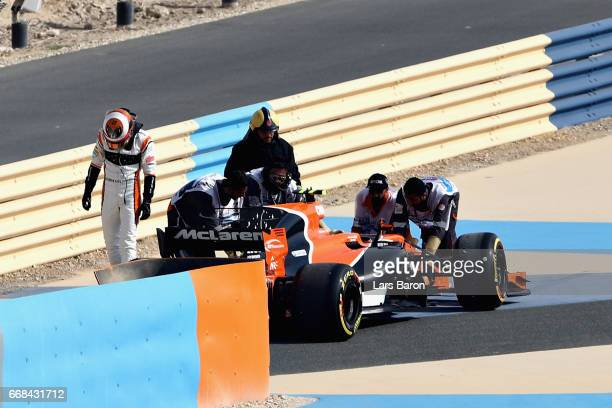 Stoffel Vandoorne of Belgium and McLaren Honda walks from his car after breaking down on track during practice for the Bahrain Formula One Grand Prix...