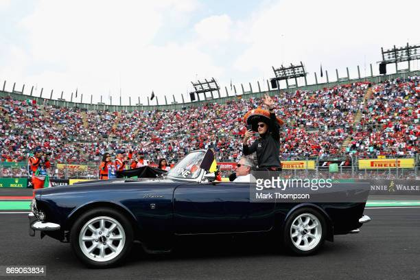 Stoffel Vandoorne of Belgium and McLaren Honda waves to the crowd on the drivers parade before the Formula One Grand Prix of Mexico at Autodromo...