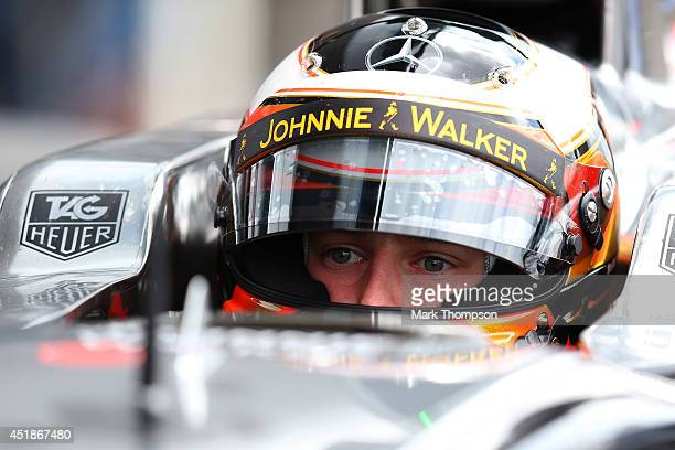 Stoffel Vandoorne of Belgium and McLaren sits in his car during day one of testing at Silverstone Circuit on July 8 2014 in Northampton England