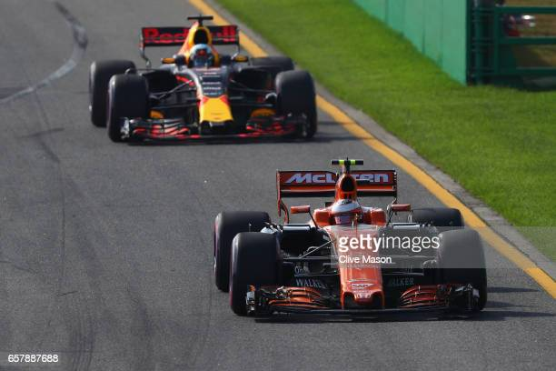Stoffel Vandoorne of Belgium driving the McLaren Honda Formula 1 Team McLaren MCL32 leads Daniel Ricciardo of Australia driving the Red Bull Racing...