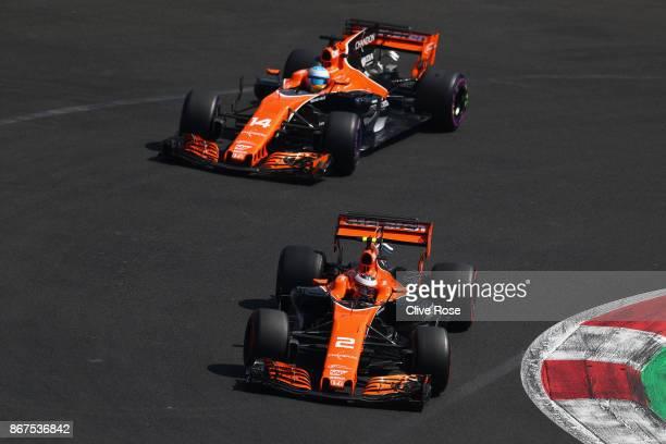 Stoffel Vandoorne of Belgium driving the McLaren Honda Formula 1 Team McLaren MCL32 and Fernando Alonso of Spain driving the McLaren Honda Formula 1...
