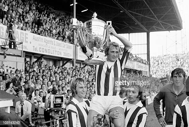 Stoke City captain Jimmy Greenhoff holds the trophy aloft whilst being carried by teammates Denis Smith and John Marsh after their 20 victory over...