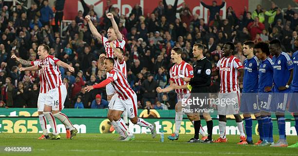 Stoke City celebrate after he final penalty during the Capital One Cup tie between Stoke City and Chelsea at Britannia Stadium on October 27 2015 in...