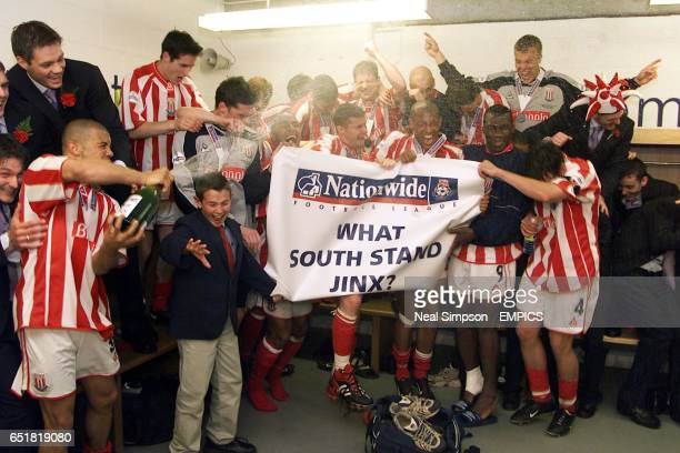 Stoke City celebrate winning promotion in the South Stand dressing room