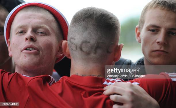 A Stoke City fan with the club initials shaved into the back of his head