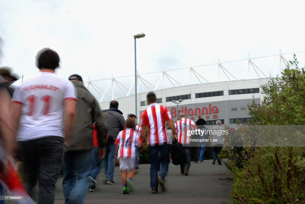 Stoke City fans arrive at the Britannia Stadium during the Barclays Premier League match between Stoke City and Crystal Palace at Britannia Stadium on August 24, 2013 in Stoke on Trent, England.