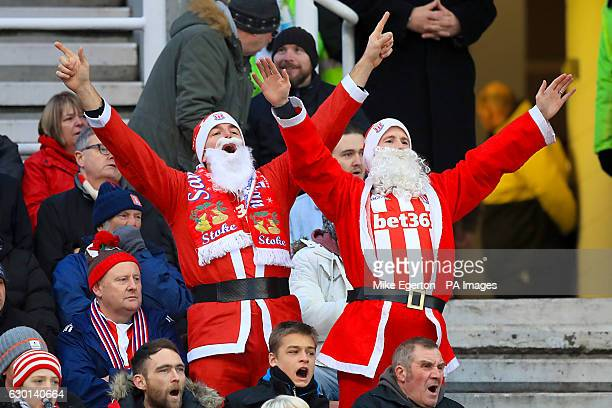 Stoke City fans in the stands in christmas fancy dress celebrates during the Premier League match at the Bet365 Stadium Stoke