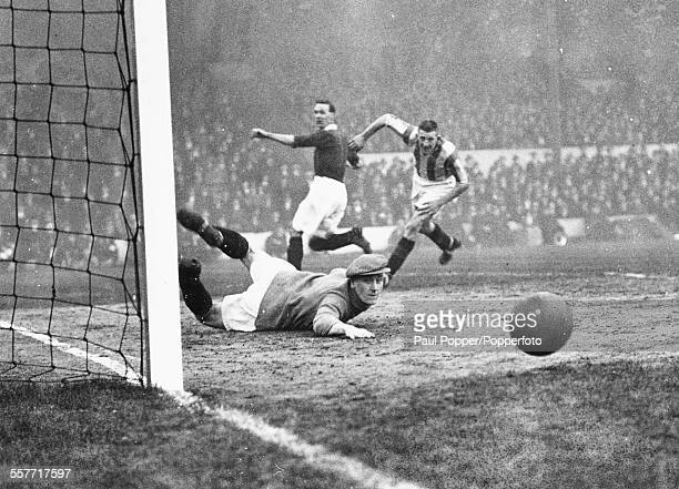 Stoke City goalkeeper Dick Williams diving to save a goal from Arsenal player David Jack during a football game between the Arsenal and Stoke City at...