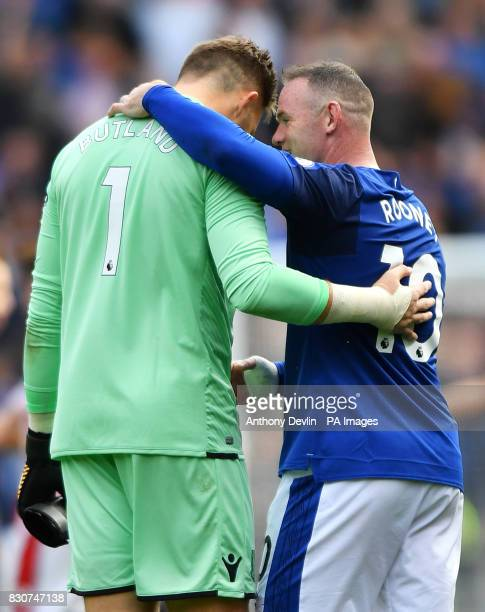 Stoke City goalkeeper Jack Butland and Everton's Wayne Rooney after the Premier League match at Goodison Park Liverpool