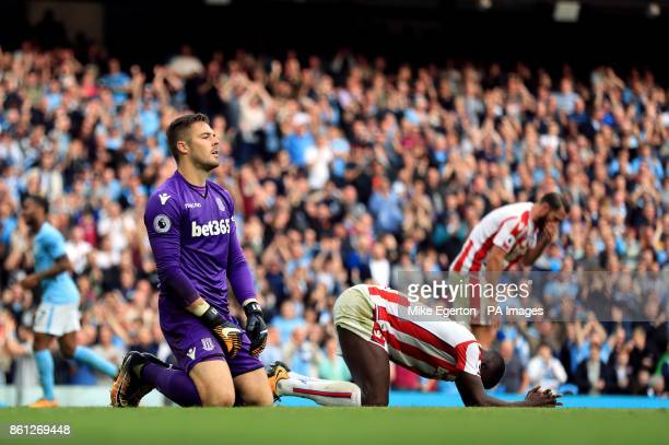 Stoke City goalkeeper Jack Butland and his teammates appear dejected after conceding a seventh goal during the Premier League match at Etihad Stadium...