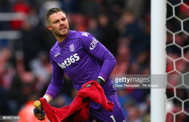 Stoke City goalkeeper Jack Butland asks the fans to stop booing as he leaves the pitch at halftime during the Premier League match at the bet365...