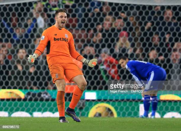 Stoke City goalkeeper Jack Butland celebrates after saving Chelsea's Eden Hazard's penalty in the shoot out