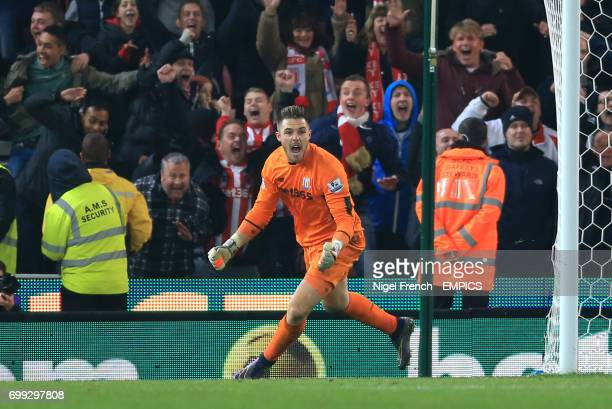 Stoke City goalkeeper Jack Butland celebrates after saving from Chelsea's Eden Hazard in the penalty shoot out