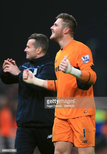 Stoke City goalkeeper Jack Butland celebrates victory against Chelsea with teammate Shay Given