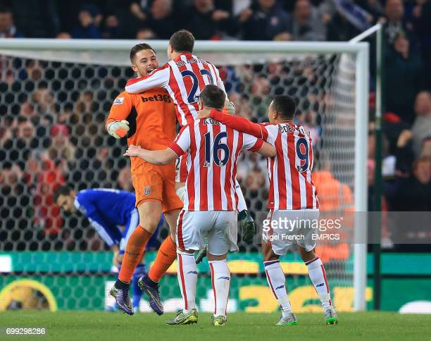 Stoke City goalkeeper Jack Butland celebrates with his team mates after saving Chelsea's Eden Hazard's penalty in the shoot out