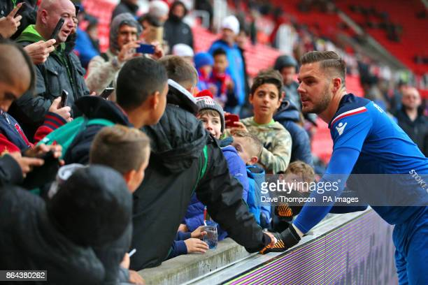 Stoke City goalkeeper Jack Butland poses for photographs with fans before the Premier League match at the bet365 Stadium StokeonTrent