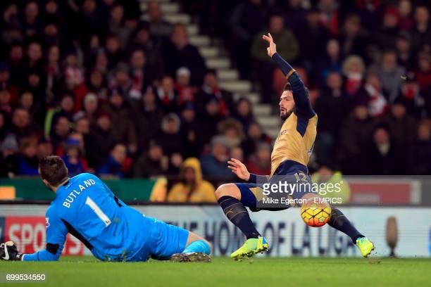 Stoke City goalkeeper Jack Butland saves from Arsenal's Olivier Giroud