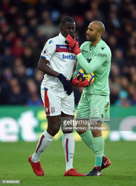 Stoke City goalkeeper Lee Grant checks on team mate Kurt Zouma after a clash in the box during the Premier League match at the Selhurst Park London