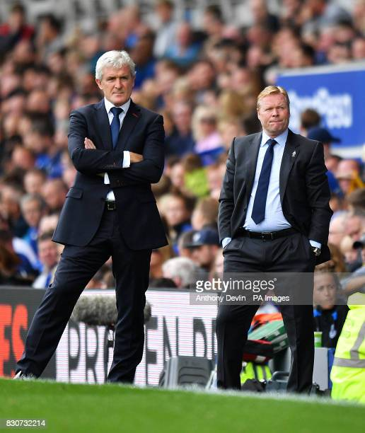 Stoke City manager Mark Hughes and Everton manager Ronald Koeman during the Premier League match at Goodison Park Liverpool