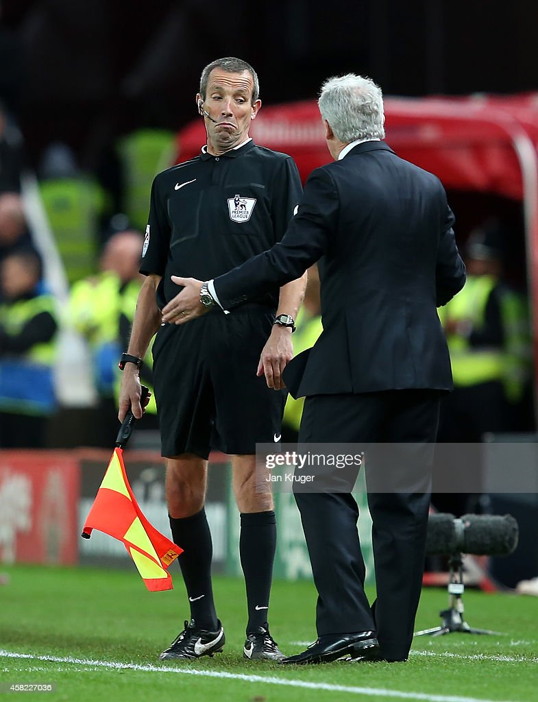 Stoke City Manager Mark Hughes protests to the Assistant Referee during the Barclays Premier League match between Stoke City and West Ham United at...