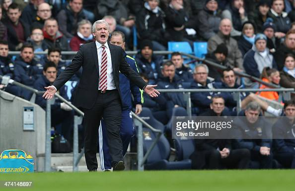 Stoke City manager Mark Hughes shows his emotions during the Barclays Premier League match between Manchester City and Stoke City at the Etihad...