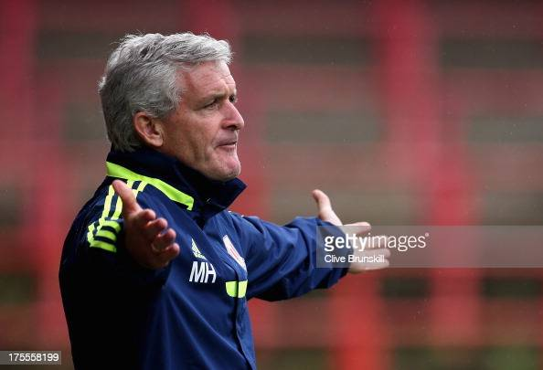 Stoke City manager Mark Hughes shows his frustrations as he watches his new team during the pre season friendly match between Wrexham AFC and Stoke...