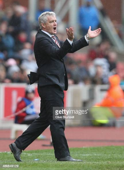 Stoke City manager Mark Hughes shows his frustrations during the Barclays Premier League match between Stoke City and Tottenham Hotspur at the...