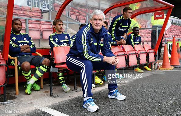 Stoke City manager Mark Hughes watches his new team during the pre season friendly match between Wrexham AFC and Stoke City at Racecourse Ground on...