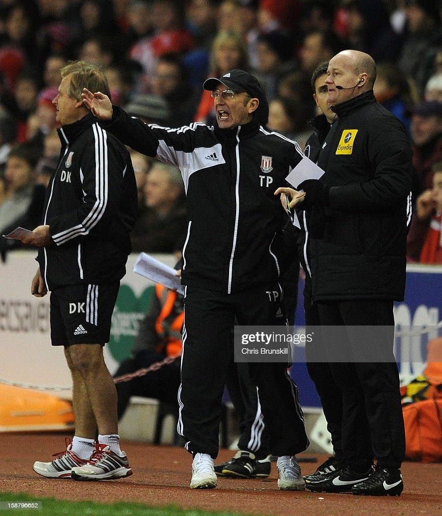 Stoke City manager Tony Pulis complains to fourth official Lee Mason during the Barclays Premier League match between Stoke City and Southampton at Britannia Stadium on December 29, 2012 in Stoke on Trent, England.