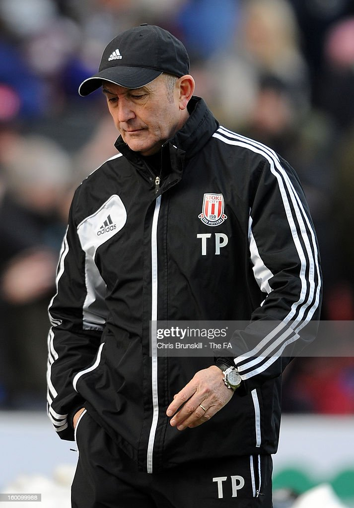 Stoke City manager <a gi-track='captionPersonalityLinkClicked' href=/galleries/search?phrase=Tony+Pulis&family=editorial&specificpeople=2225291 ng-click='$event.stopPropagation()'>Tony Pulis</a> looks dejected following the FA Cup with Budweiser Fourth Round match between Stoke City and Manchester City at Britannia Stadium on January 26, 2013 in Stoke on Trent, England.