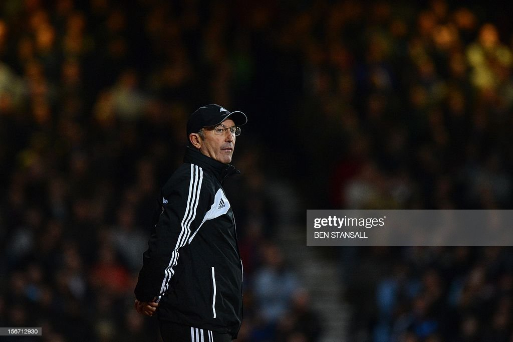 "Stoke City manager Tony Pulis looks on during the English Premier League football match between West Ham and Stoke City at the Boleyn Ground, Upton Park, in East London, England, on November 19, 2012. USE. No use with unauthorized audio, video, data, fixture lists, club/league logos or ""live"" services. Online in-match use limited to 45 images, no video emulation. No use in betting, games or single club/league/player publications."