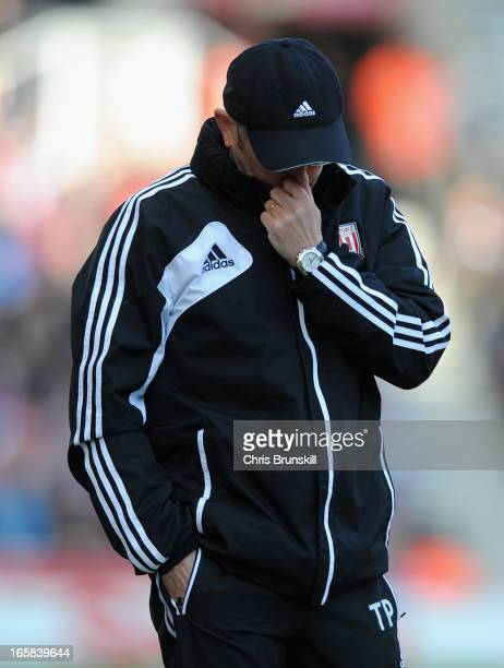 Stoke City Manager Tony Pulis reacts during the Barclays Premier League match between Stoke City and Aston Villa at the Britannia Stadium on April 6...