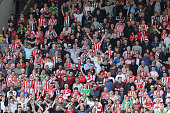 Stoke City supporters in good voice during the Barclays Premier League match between Watford and Sunderland at Vicarage Road on May 15 2016 in...
