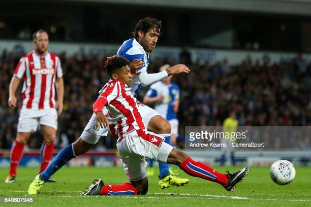 Stoke City U23s' Tre Pemberton beats Blackburn Rovers' Danny Graham to the ball during the match EFL Checkatrade Trophy Northern Section Group C...