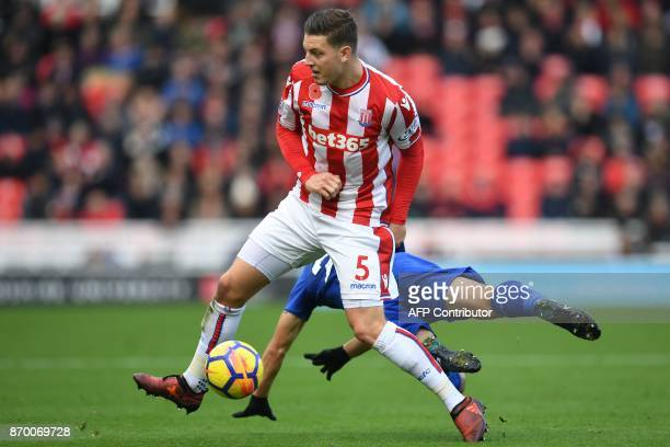 Stoke City's Austrian defender Kevin Wimmer vies with Leicester City's Japanese striker Shinji Okazaki during the English Premier League football...